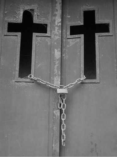 Cross on door and chains